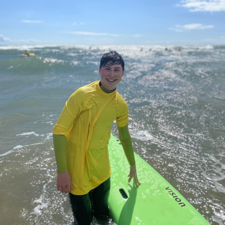A boy surfing at Bantham Beach