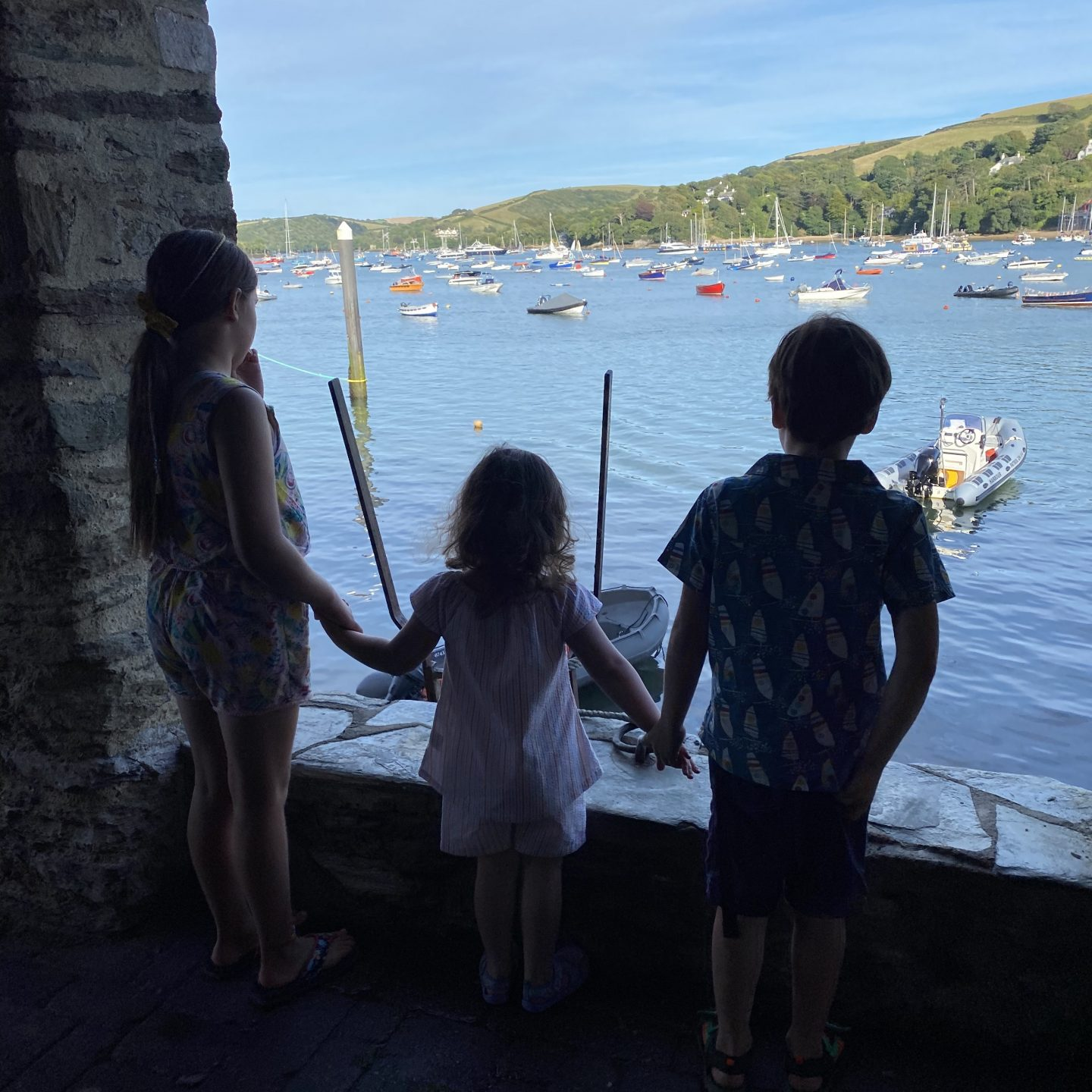 A view from Salcombe harbour with 3 children looking at boats