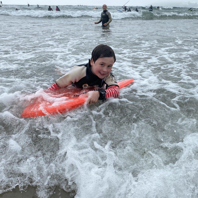 A boy body boarding at Batman beach