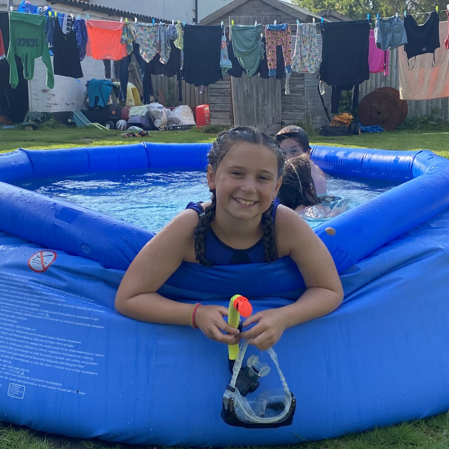 Heatwave in York with a paddling pool and a  washing line