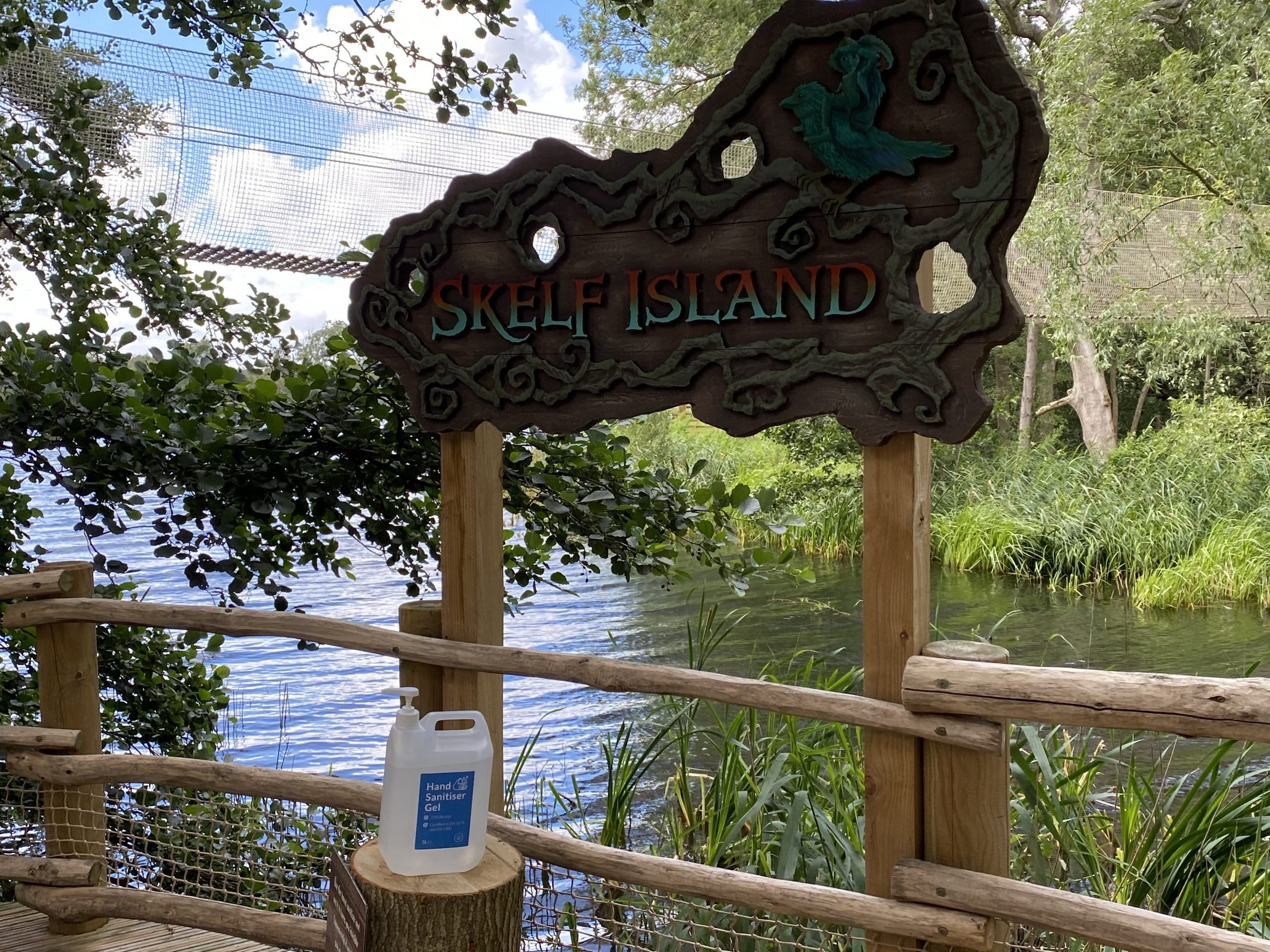 Skelf island sign with some  hand sanitiser below