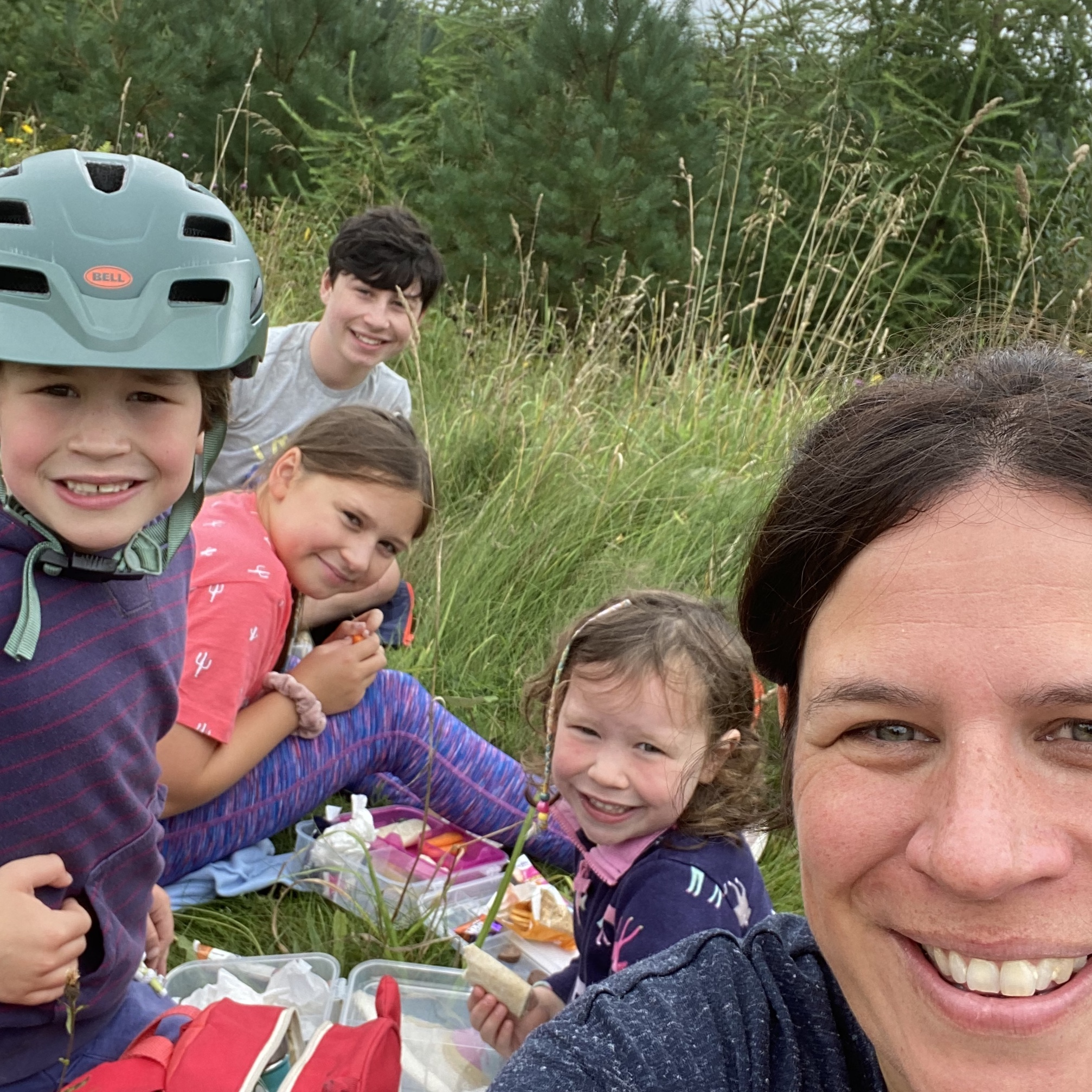 a mum and 4 children smiling after a cycle ride in Dalby forest