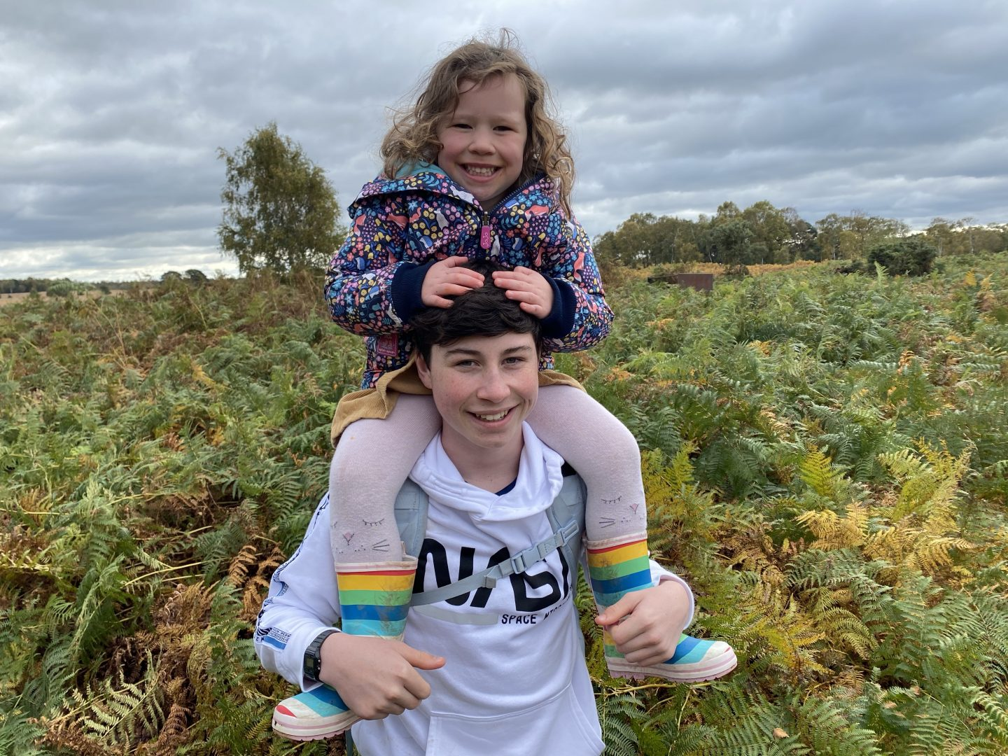 an ordinary family week with a teenager carrying his younger sister