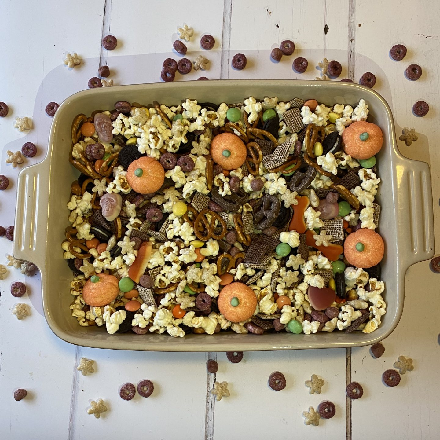 a serving dish filled with Halloween sweets and popcorn