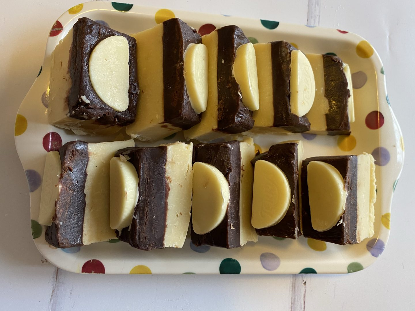 Terry's chocolate orange fudge recipe with fudge pieces sat on a plate