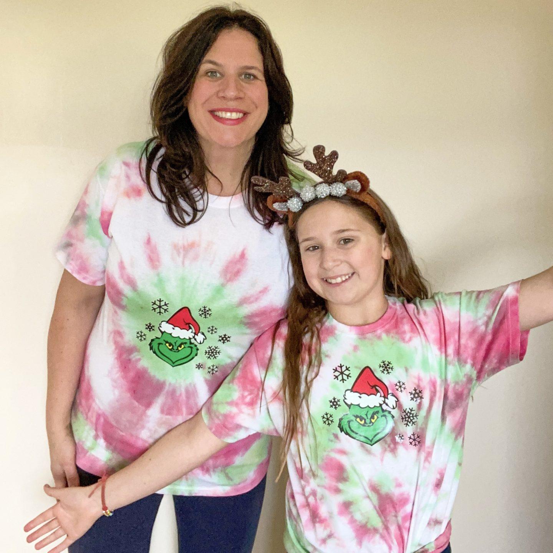 Mum and daughter in tie dye kit U.K. Grinch designs