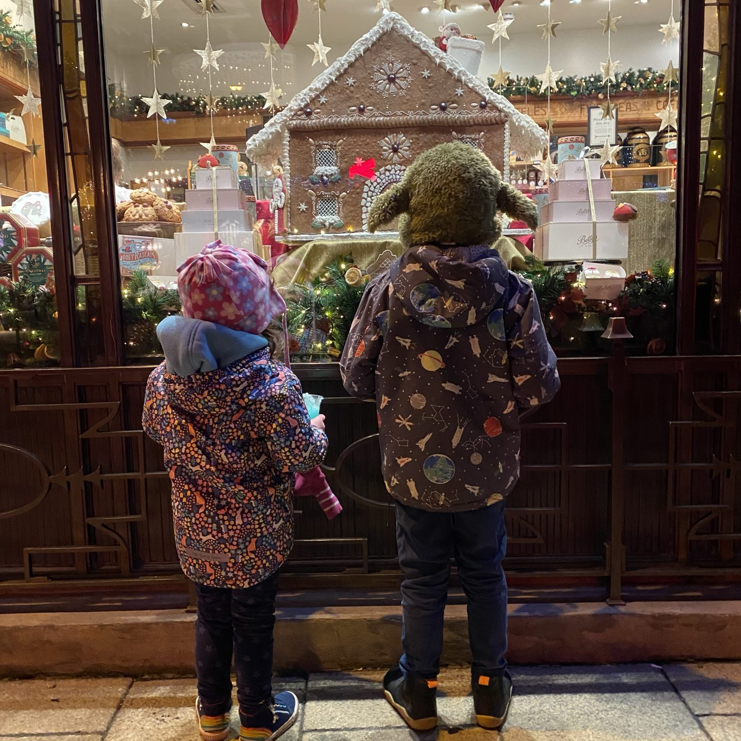 two children looking in the betty's tearoom Christmas window