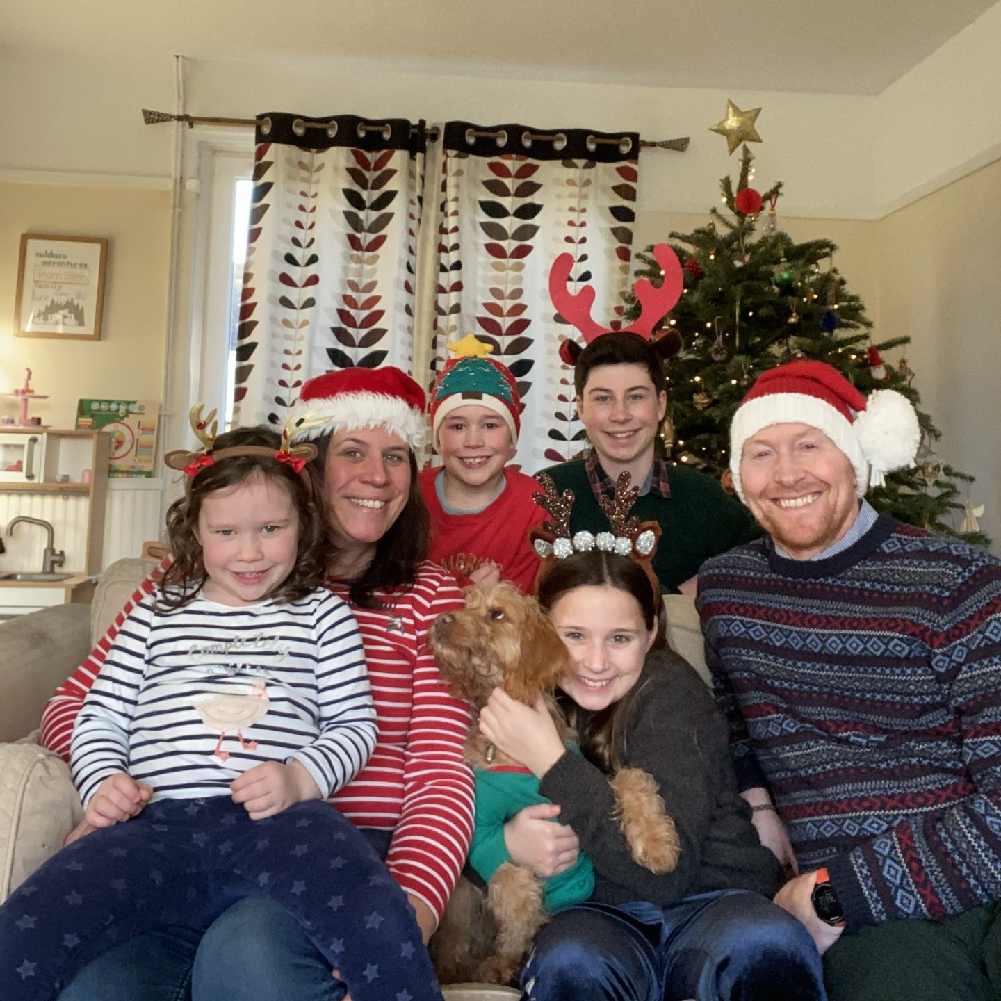 Last Living Arrows with a Christmas family photo all sat on the sofa smiling