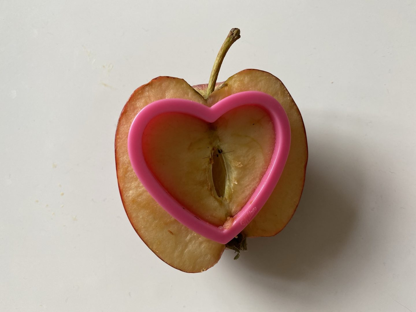 apple with a cookie cutter