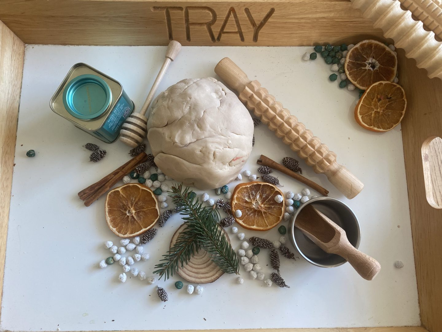 natural play dough with foliage and wooden tools