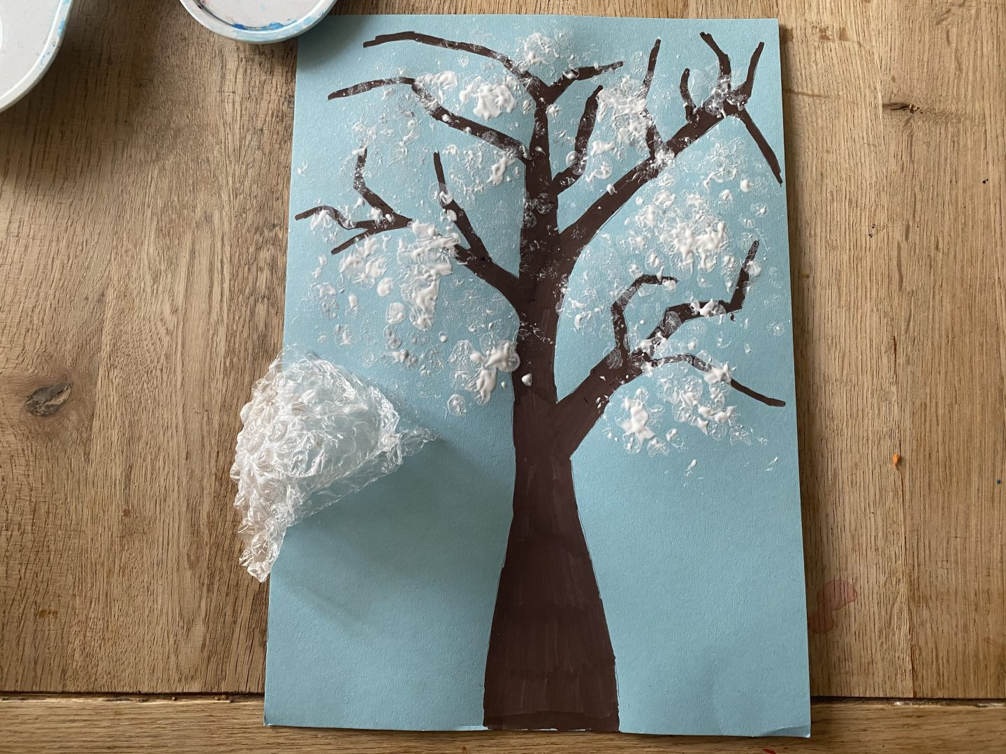 a tree painted with bubble wrap and paint