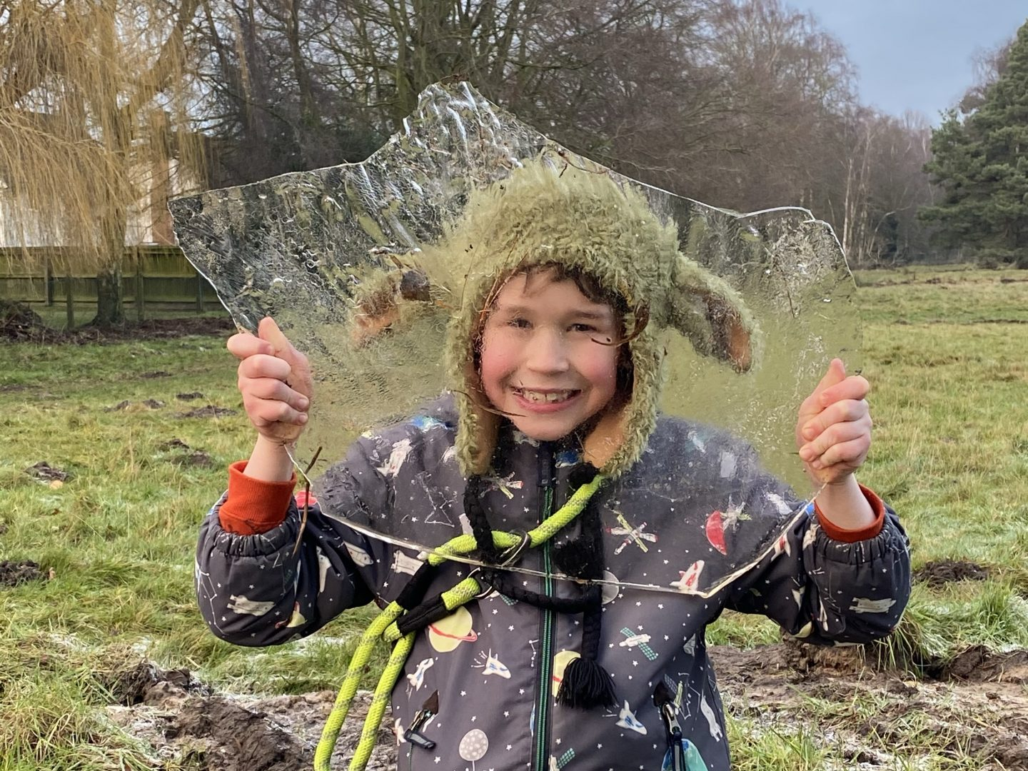 a young boy holding up ice and smiling