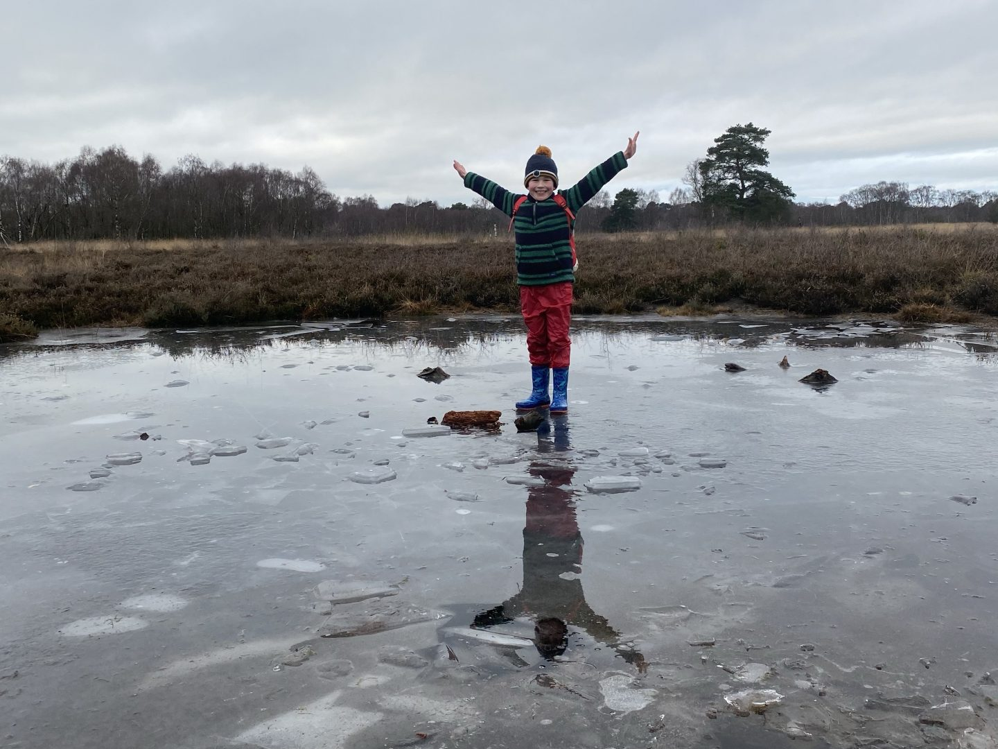 A boy standing on the ice