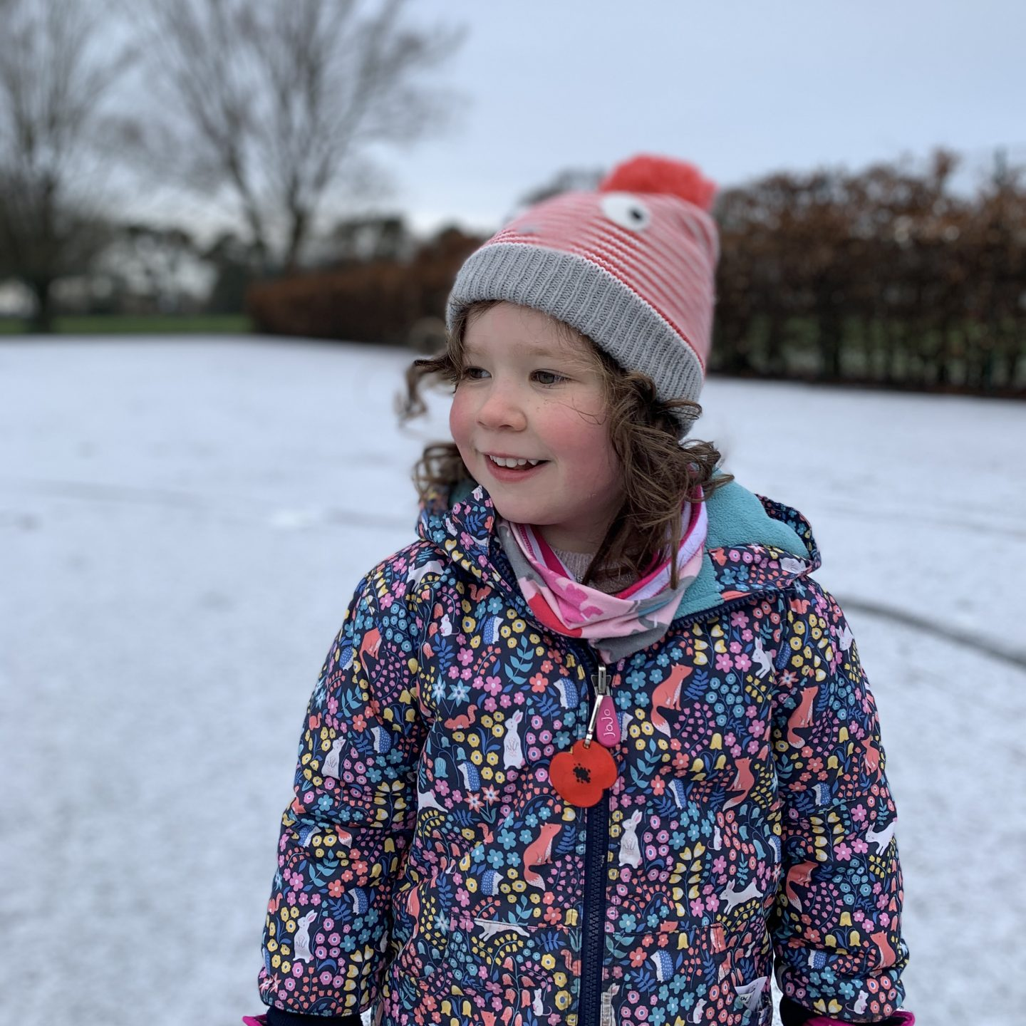 a young girl smiling in the snow