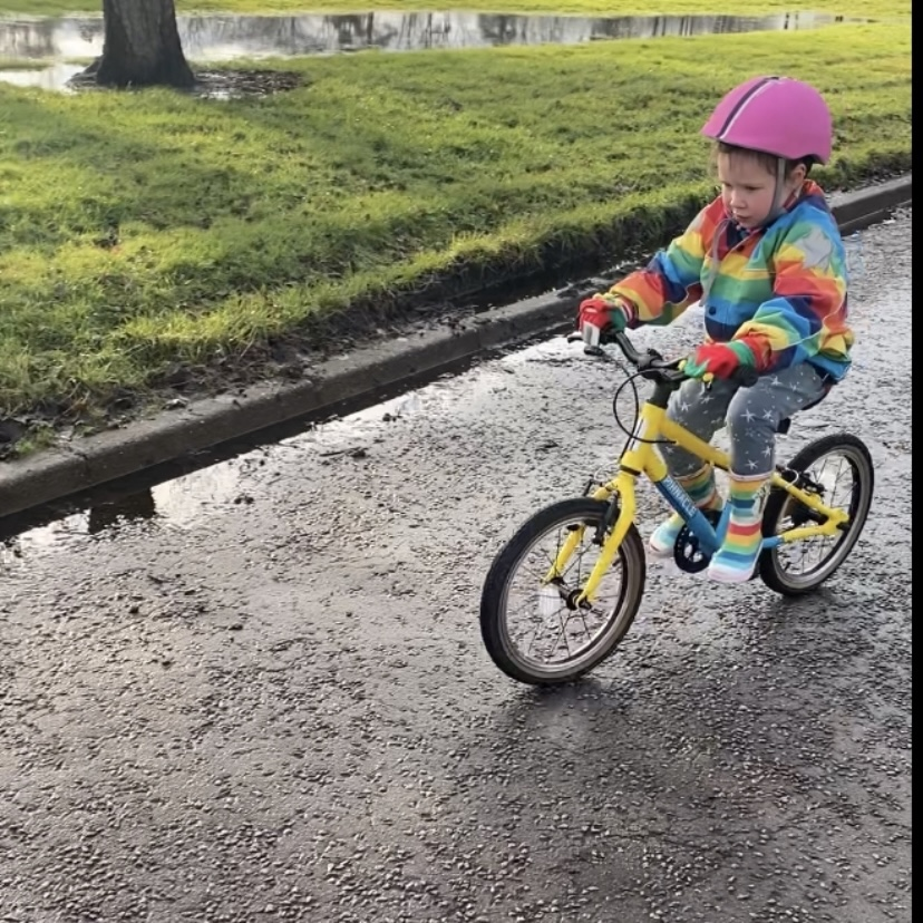 a small child cycling on a bike