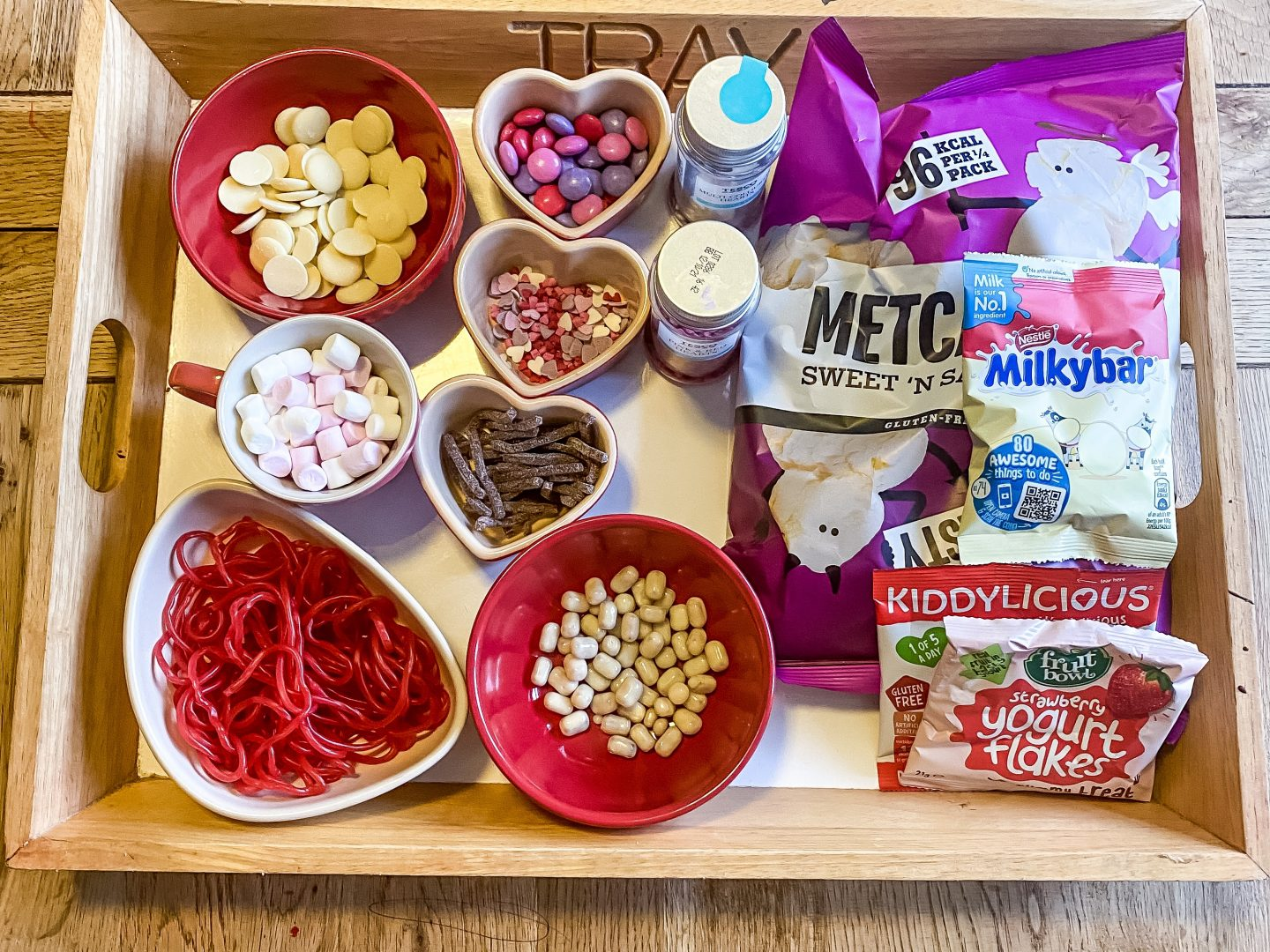 a tray of snacks for a Valentine's movie snack mix