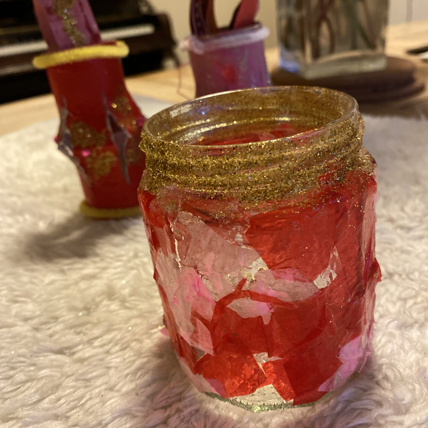 decorated jar with glitter and tissue paper