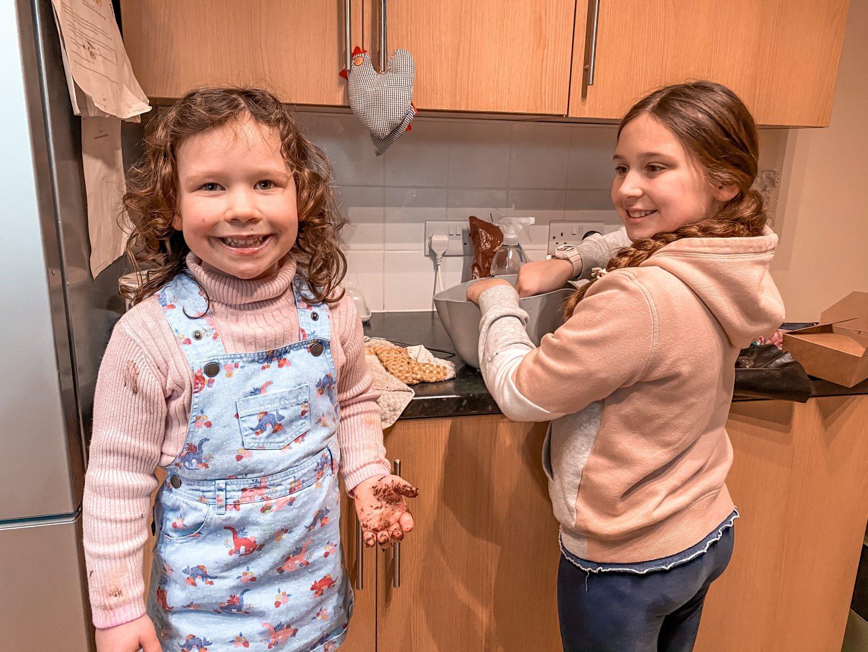 Valntine's baking with two girls making chocolate truffles.