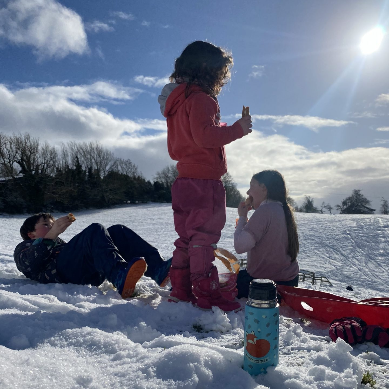 3 children enjoying the snow